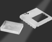 Custom one-piece EMI shields offer outstanding attenuation combined with excellent coplanarity for ease of assembly.